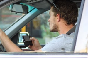 Texting while driving by Lord Jim (Flickr)