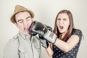 Couple fighting with gloves